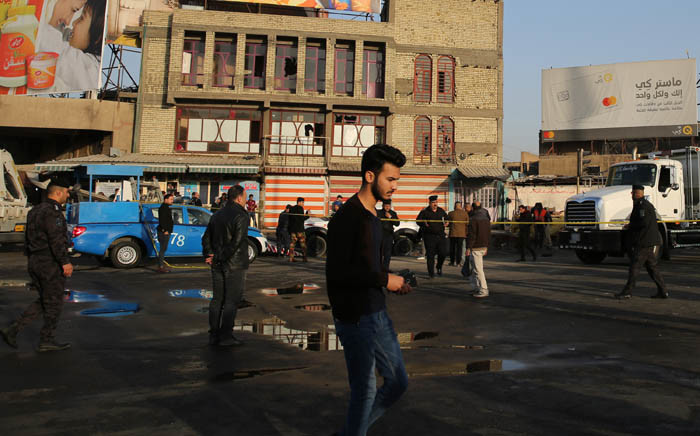Iraqi security forces cordon off the area where a double suicide bombing killed more than 20 people in central Baghdad on 15 January 2018. Picture:  AFP