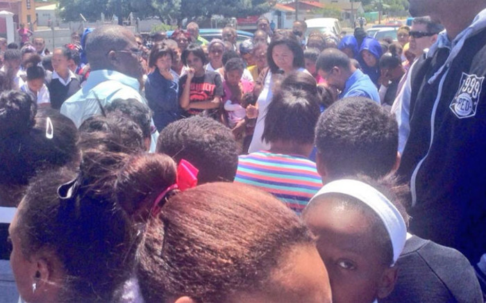 Uitsig community members gather at the spot where a grade 11 pupil was murdered on 9 November. Picture: Giovanna Gerbi/EWN.