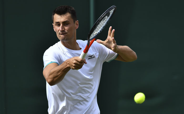 Australia's Bernard Tomic returns against France's Jo-Wilfried Tsonga during their men's singles first round match on the second day of the 2019 Wimbledon Championships at The All England Lawn Tennis Club in Wimbledon, southwest London, on 2 July 2019. Picture: AFP