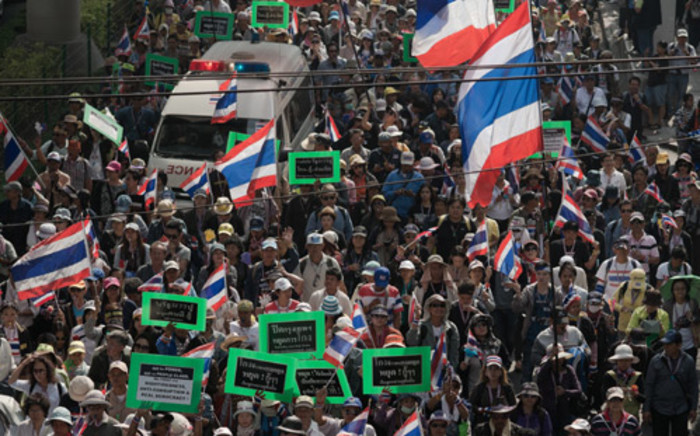 Thai anti-government protesters march in the streets during a rally in Bangkok on 23 January, 2014. Defiant Thai opposition protesters vowed to ignore a state of emergency that came into force across the tense capital on 22 January, refusing to abandon their fight to bring down the government. Picture: AFP.