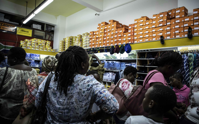 FILE: Parents purchasing school uniforms and supplies for their children the day before schools reopen. Picture: Abigail Javier/EWN
