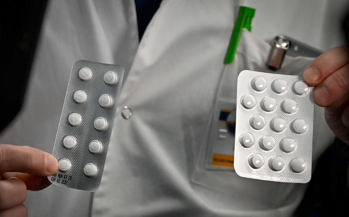 FILE: Medical staff at the IHU Mediterranee Infection Institute in Marseille show packets of Nivaquine, tablets containing chloroquine, and Plaqueril, which contain hydroxychloroquine. Picture: AFP