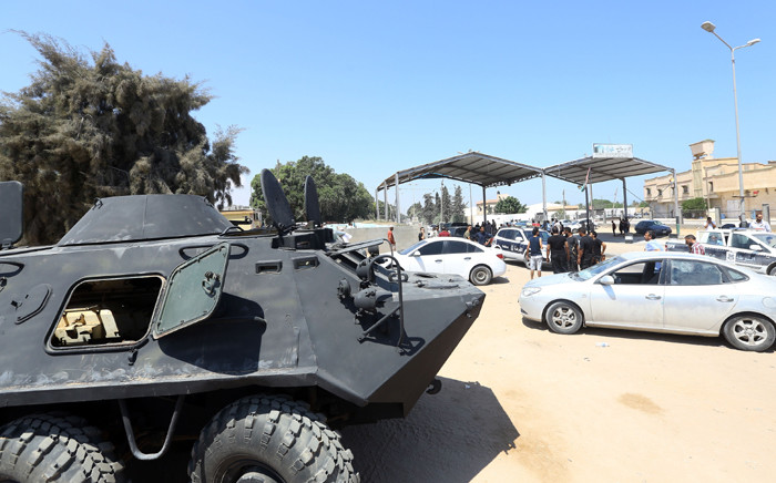 Libyan security stand guard on 23 August 2018 near the site of an attack on a checkpoint in the city of Zliten, 170 km east of the capital Tripoli. Picture: AFP.