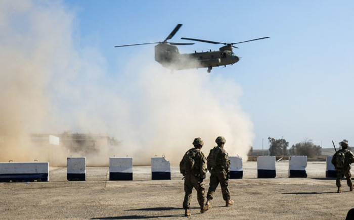 A US Army C-47 Chinook helicopter flies over the village of Oreij, south of Mosul, on February 22, 2017. Picture: AFP
