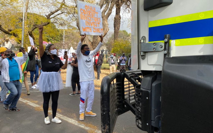 Protesters outside the Zimbabwean High Commission in Pretoria have come out in support of Zimbabwean following reports of human  right violations. Picture: Abigail Xavier/EWN
