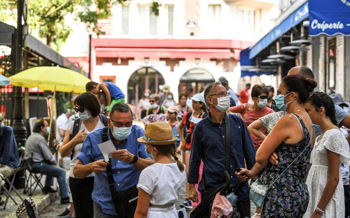 People wearing a protective facemask visit the Montmartre neighbourhood, in Paris, on 11 August 2020 as the mayor decided to make the mask compulsory in certain areas of the city to fight against the rising of new infected cases of COVID-19. Picture: AFP