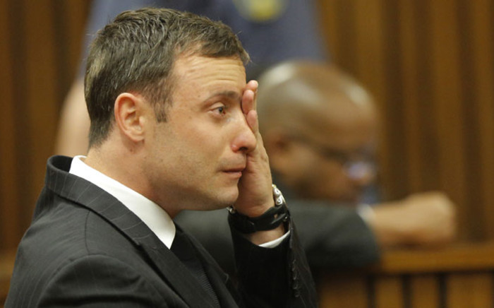 FILE: Oscar Pistorius cries while seated in the dock during the judgment in his murder trial in Pretoria on 11 September 2014. Picture: Pool.