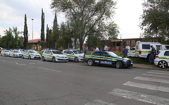 Police gathered at the Katlehong police station following looting of multiple businesses on Saturday 12 March 2016. Picture Kgothatso Mogale/EWN