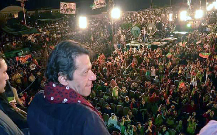 Chairman of Pakistan's Tehreek-e-Insaaf party (PTI), Imran Khan, addresses thousands of people at Azadi Square outside the country's Parliament in August 2014. Picture: Official PTI Facebook page.