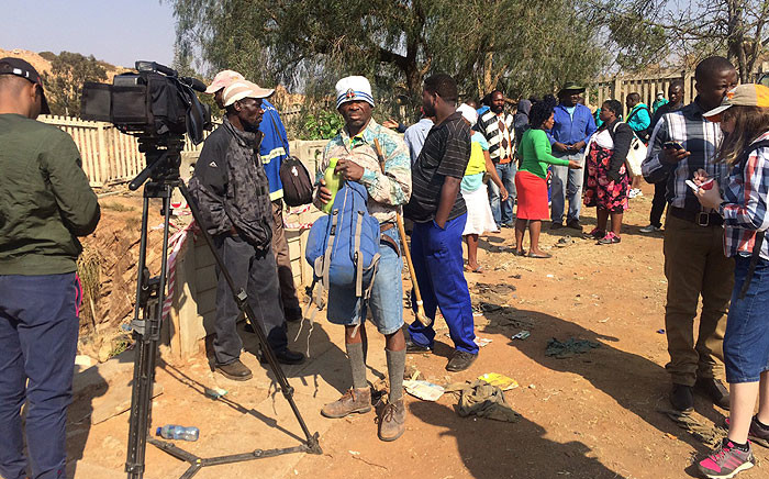 FILE: Community members gathered near the Langlaagte site where illegal miners were trapped underground on 12 September 2016. Picture: Masa Kekana/EWN.