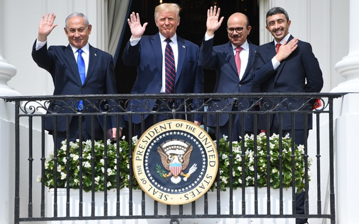 (L-R) Israeli Prime Minister Benjamin Netanyahu, US President Donald Trump, Bahrain Foreign Minister Abdullatif al-Zayani, and UAE Foreign Minister Abdullah bin Zayed Al-Nahyan wave from the Truman Balcony at the White House after they participated in the signing of the Abraham Accords where the countries of Bahrain and the United Arab Emirates recognize Israel, in Washington, DC, 15 September 2020. Picture: AFP