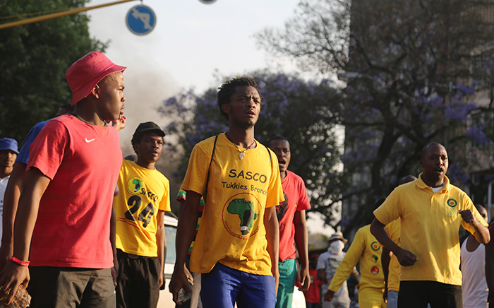 Students prepare to face off with police in the streets of Pretoria during protests over a proposed university tuition fee increases on 23 October 2015. Picture: Reinart Toerien/EWN