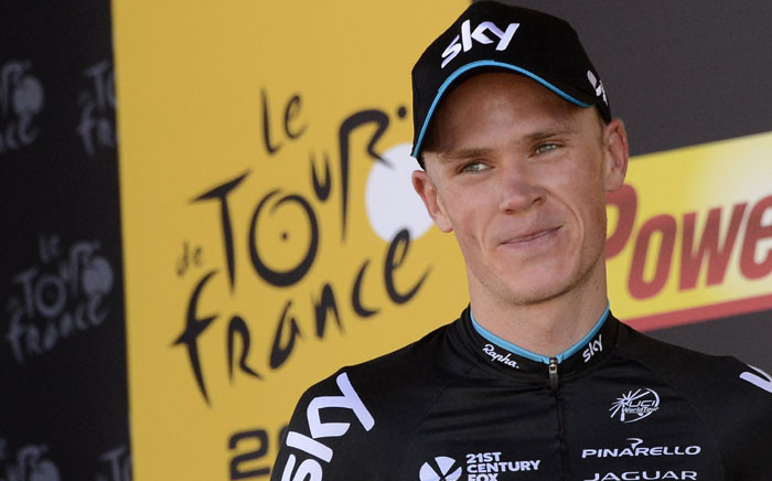 Great Britain's Christopher Froome celebrates on the podium after winning the 167 km tenth stage of the 102nd edition of the Tour de France cycling race on 14 July, 2015, between Tarbes and La Pierre-Saint-Martin, southwestern France. Picture: AFP.