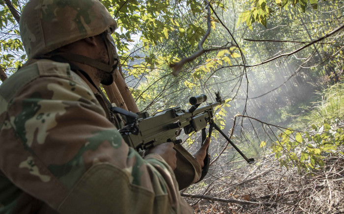 FILE: An SANDF LMG gunner fires suppressing rounds during a live-fire training exercise before deploying to the DRC for peace-keeping mission. Picture: Thomas Holder/EWN