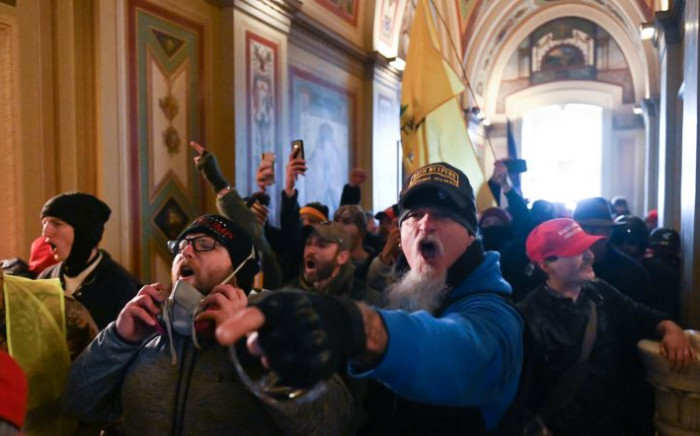 In this file photo taken on 6 January 2021, supporters of US President Donald Trump protest inside the US Capitol in Washington, DC. Picture: ROBERTO SCHMIDT/AFP
