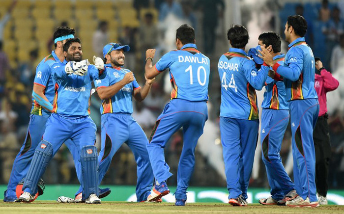 Afghanistan's players celebrate after winning the World T20 cricket tournament match against West Indies at The Vidarbha Cricket Association Stadium in Nagpur on 27 March, 2016. Picture: AFP.