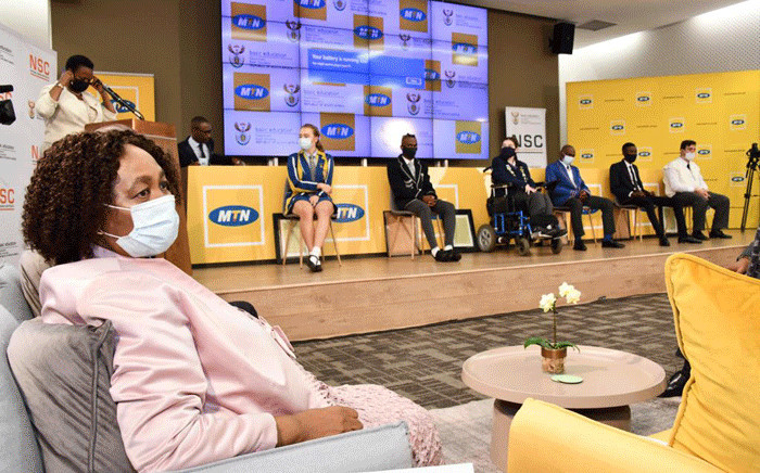 Basic Education MinisterAngie Motshekga (L) and some top performers on the stage on 22 February 2021 at the announcement of the 2020 matric results. Picture: GCIS.