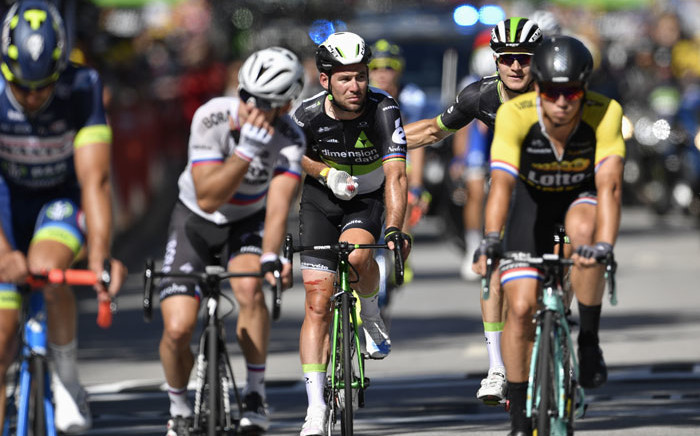 Team Dimension Data rider Mark Cavendish (2nd left) crosses the finish line after falling at the end of the 207,5km fourth stage of the 104th edition of the Tour de France cycling race on July 4, 2017 between Mondorf-les-Bains and Vittel. Picture: AFP