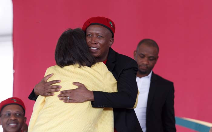 Julius Malema welcomes Cape Town Mayor Patricia de Lille during the memorial service for Winnie Madikizela-Mandela held by the EFF in Brandfort. Picture: Christa Eybers/EWN.