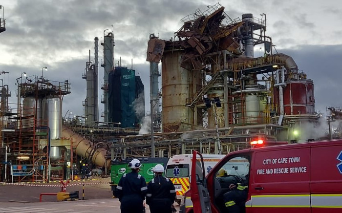 Emergency teams respond to the explosion at Astron Energy's Milnerton refinery. Image: Yusuf Abramjee/Twitter
