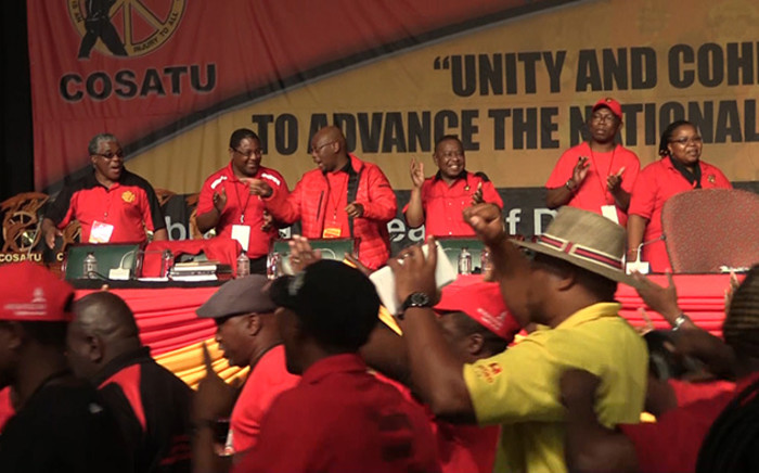 SACP leader Blade Nzimande is joined by Cosatu members in song at the union federation's National Congress. Picture: Vumani Mkhize/EWN.