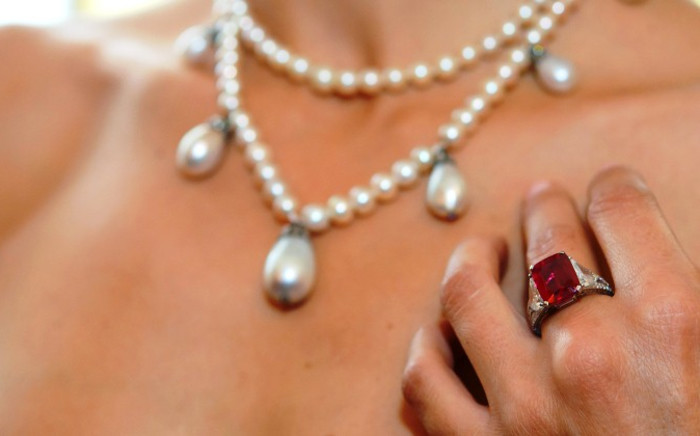 FILE: A Sotheby's employee shows a Graff Ruby, weighing 8.62 carats, during a preview at Sotheby's auction house, in Geneva, Switzerland, 05 November 2014. Picture: EPA.
