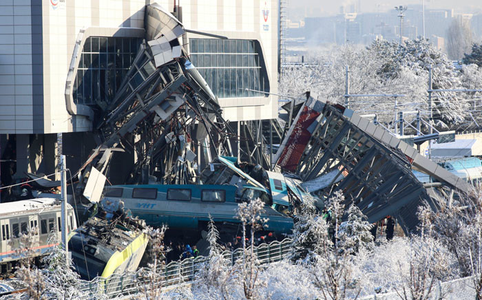 This picture taken on 13 December 2018 shows the train's wreckage after a high-speed train crashed into a locomotive in Ankara. Nine people were killed and nearly 50 injured in this train accident. Picture: AFP
