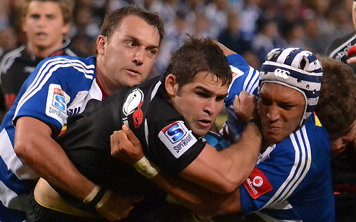 FILE:Sharks scrumhalf Cobus Reinach on the attack against the Stormers in Cape Town on 13 April 2013. Picture: Aletta Gardner/EWN