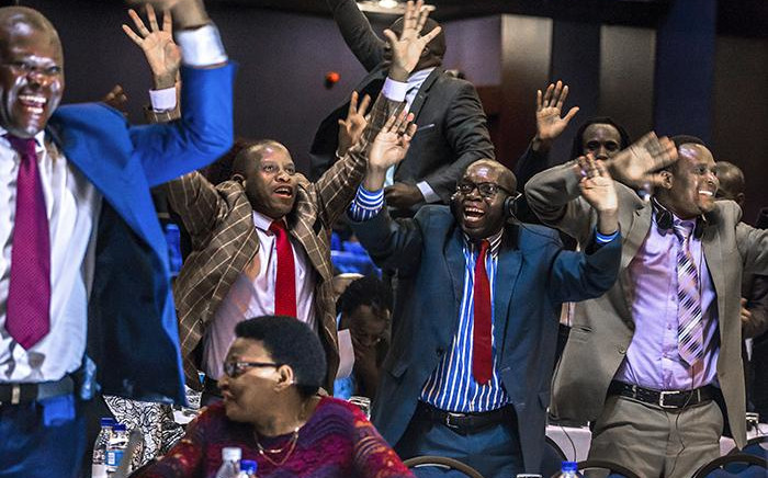 Zimbabwe's Members of Parliament celebrate after Robert Mugabe's resignation on 21 November 2017 in Harare. Picture: AFP.
