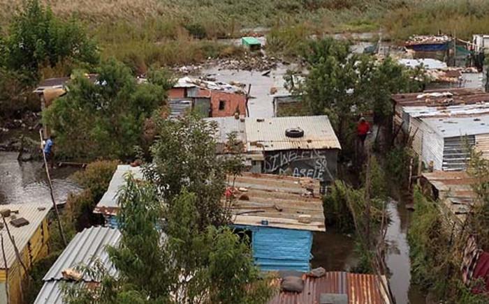 Flooding in Kliptown, Soweto, 20 April 2013. Picture: Govan Whittles/EWN.