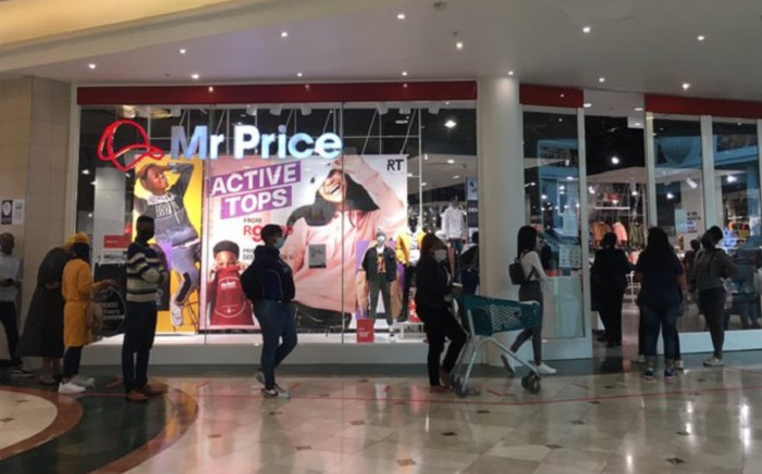 Shoppers on 2 May 2020 queue at a Mr Price store at Canal Walk Shopping Centre in Cape Town. Picture: Jarita Kassen/EWN.