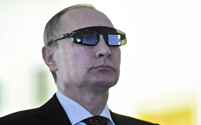 FILE. Russian President Vladimir Putin, wearing special glasses, looks on as he visits a laboratory at the Gornyy National Mineral Resources University in St. Petersburg on 26 January, 2015. Picture: AFP