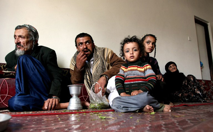 Jewish Rabbi Youssef Moussa, his nephew Haboub and his children Said and Jamil, and Nemaa, the Rabi's wife, sit in an apartment in Sanaa on 10 November, 2009 that was given to the family by the Yemeni government after fleeing from the conflict area in north Yemen. Picture: AFP