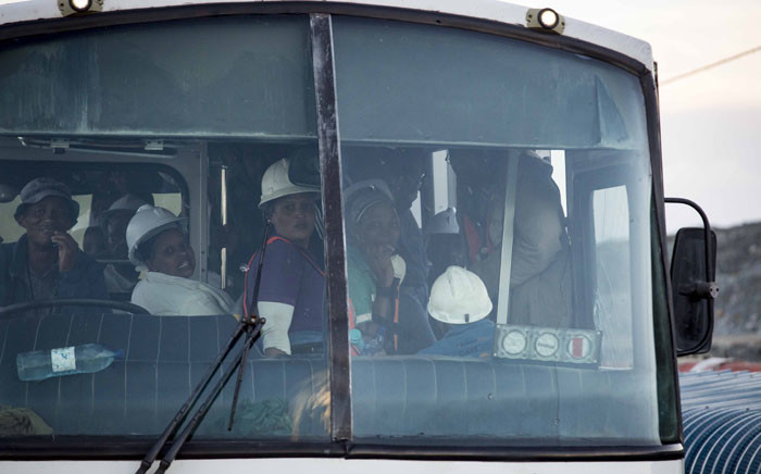 Some of the rescued miners are transported by bus from the Sibanye-Stillwater's Beatrix mine shaft 3 after being trapped underground for about 31 hours to hot showers, warm food and debriefing at the nearby shaft 1 facilities. Picture: Thomas Holder/EWN
