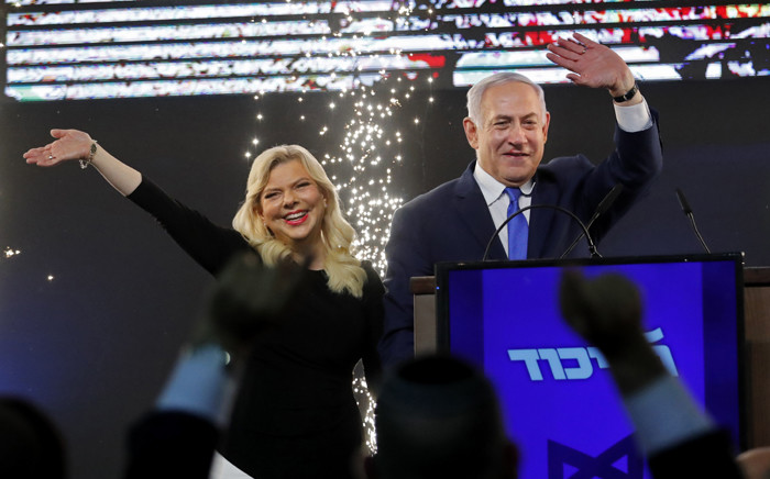 FILE: Israeli Prime Minister Benjamin Netanyahu, accompanied by his wife Sara, greets supporters on election night at his Likud Party headquarters in the Israeli coastal city of Tel Aviv early on 10 April 2019. Picture: AFP