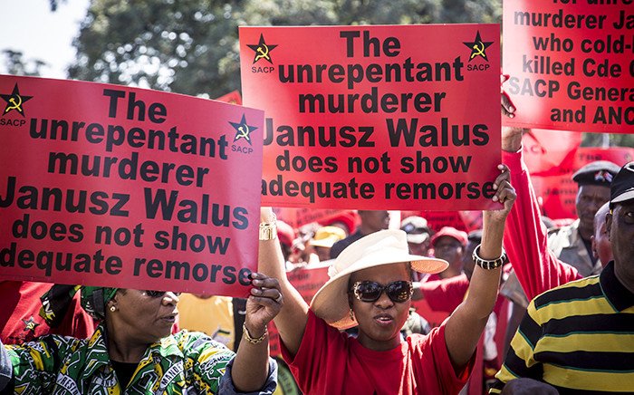 FILE. SACP supporters hold up placards during a march through Pretoria's CBD in support of Justice Minister Michael Masutha's decision to appeal the parole granted to Chris Hani's killer, Janusz Waluś. Picture: Reinart Toerien/EWN.