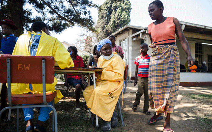 A nurse sits at a table as she takes care of cholera patients during a visit of Zimbabwe Minister of Health, at the cholera treatment centre of the Beatrice Infectious Diseases Hospital, in Harare, on 11 September 2018. Picture: AFP