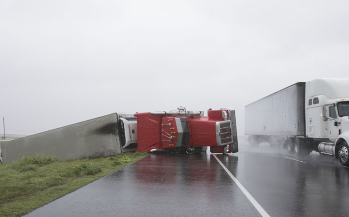A big rig lies on its side on Hwy 59 near Edna, Texas, south of Houston, in the aftermath of Hurricane Harvey on 26 August, 2017. Picture: AFP.