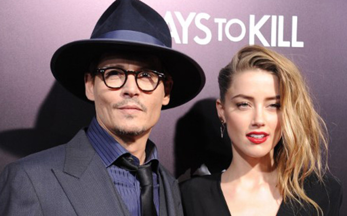 "FILE: This 12 February, 2014 file photo shows actor Johnny Depp and actress Amber Heard attending the US premiere of ""3 Days To Kill"" at Arclight Cinemas in Hollywood, California. Picture: AFP."