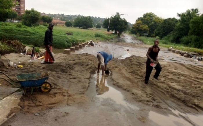 River and End Streets in Centurion were blocked with sand after heavy rain in the area on 20 November 2020. Picture: @CityTshwane/Twitter