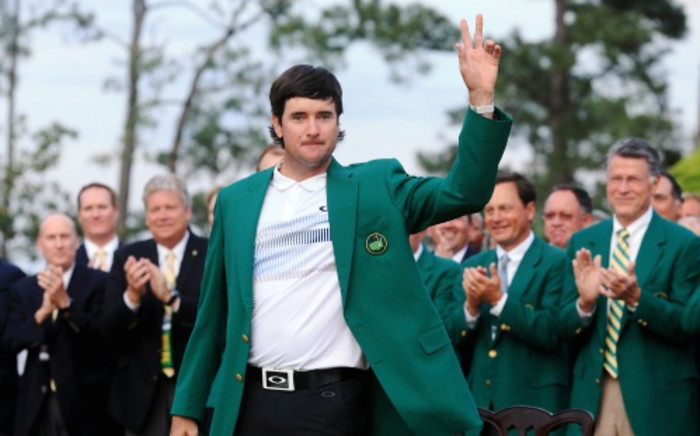 Bubba Watson poses with the green jacket after winning the 2014 Masters Tournament by a three-stroke margin at Augusta National Golf Club on 13 April 2014. Picture: AFP.