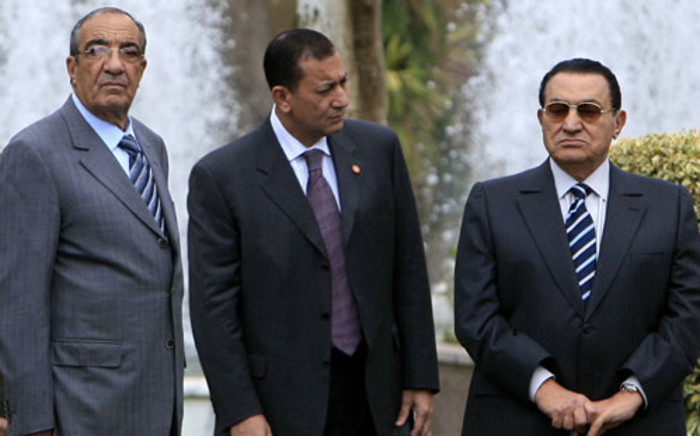 A picture taken on March 31, 2008 shows then Egyptian chief of staff Zakaria Azmi (L) standing with ousted leader Hosni Mubarak (R) in Cairo. Picture: AFP