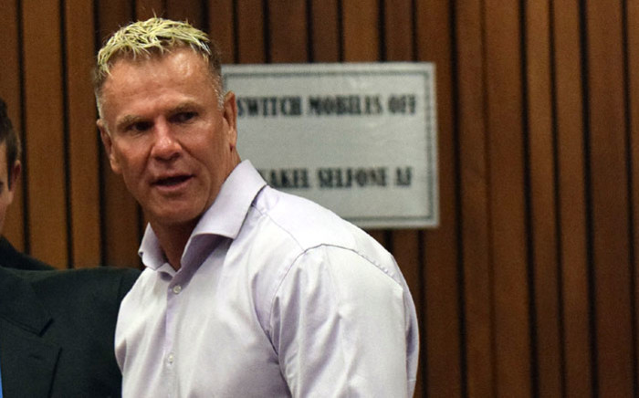 FILE: Mark Batchelor (white shirt) attends the ongoing murder trial of Paralympian athlete Oscar Pistorius in Pretoria, South Africa, on 8 April 2014. Picture: AFP