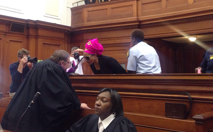 Thandi Maqubela speaking to her lawyer ahead of her sentencing in the Western Cape High Court on 31 March 2015. picture: Rahima Essop/EWN.