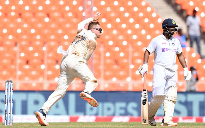 England's Dom Bess (L) bowls as India's Rishabh Pant watches on the second day of the fourth Test cricket match between India and England at the Narendra Modi Stadium in Motera on 5 March 2021. Picture: Sajjad Hussain/AFP