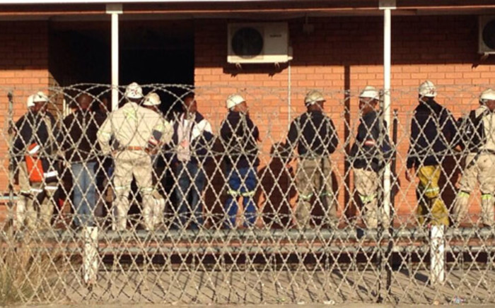 "FILE: ""Platinum Mineworkers report for work at a Lonmin shaft in Marikana on 15 May 2014. Vumani Mkhize/EWN"