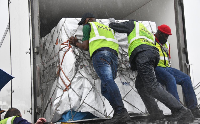 FILE: Vaccines arriving from India are loaded onto a truck at OR Tambo International Airport on 1 February 2021 before being taken to a secure location for quality assurance checks. Picture: GCIS