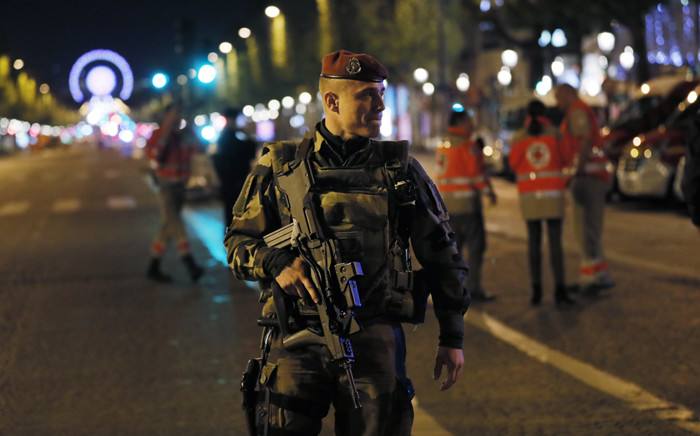 FILE: A French soldier patrols on the Champs Elysees in Paris. Picture: AFP