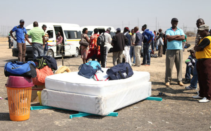 File: Marikana miners prepare to attend the funerals of some of their colleagues who were killed in August. Picture: Taurai Maduna/EWN