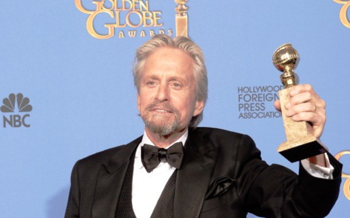 Michael Douglas won Best Actor in a Miniseries or Television Film for 'Behind the Candelabra' at the 71st Golden Globes on 12 January. Picture:AFP.